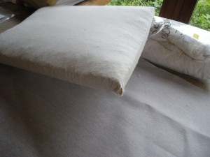 The calico-covered cushion, from above