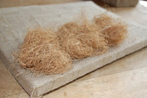 Pack bunches of coir under the twine, extending to the edge of the seat