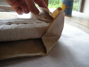 Fold the paper around the corner as shown